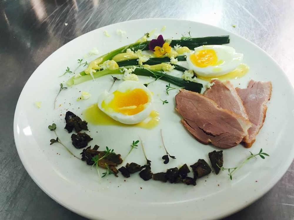 Soft boiled egg, smoked duck, morels bits and baby ieeks in a lemon butter sauce, served cold