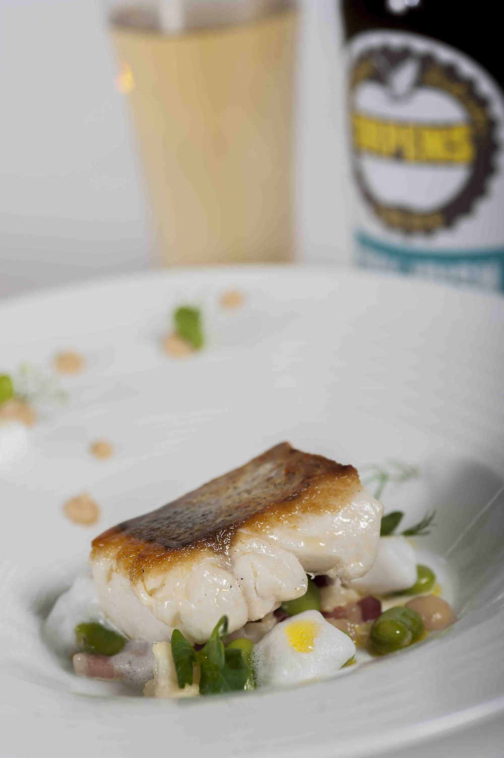 Noel McMeel's Pan Seared Fillet of Irish Hake, Roast Cauliflower Purée, Broad Beans, Bacon Lardons & Vanilla Foam