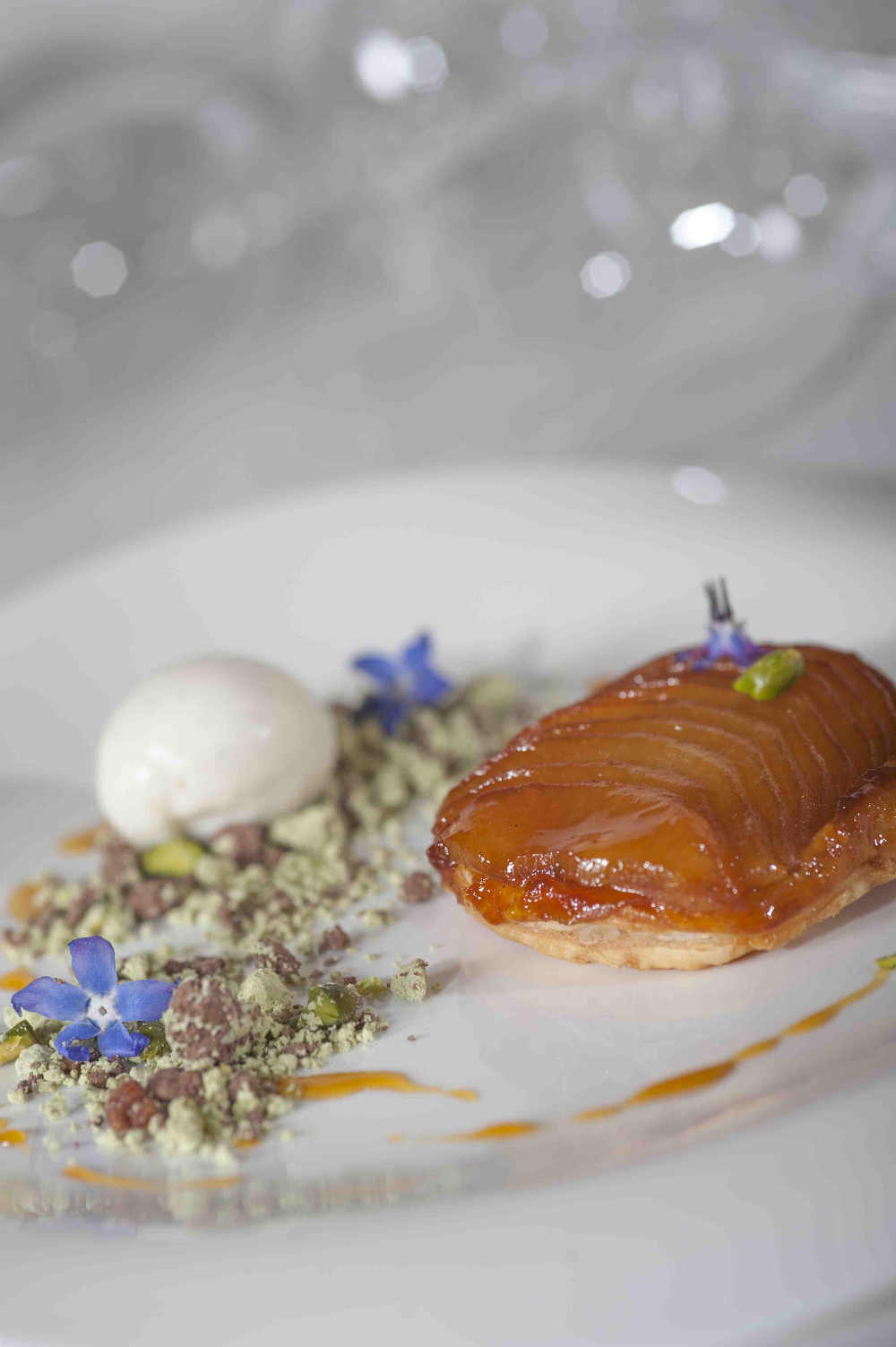 Irish Cider poached Apple Tart Tatin, Cinnamon Ice Cream, Pistachio Soil