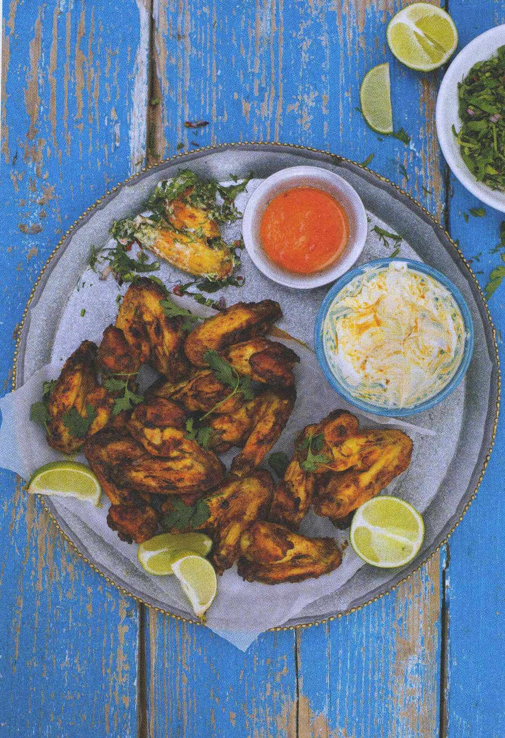 Roast chicken wings with dipping sauces and herbs
