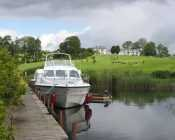 Boat on the River Shannon, Glasson  Golf Hotel, Glasson, Co. Westmeath, Ireland