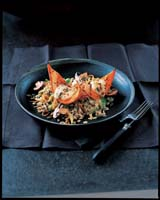 Roasted squash with Leek & Barley Pilaf - from COOKING WITH PUMPKINS AND SQUASH by Brian Glover with photography by Peter Cassidy (�9.99 in UK)