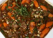 Balsamic braised beef with roast carrot and white beans